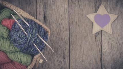 Colorful Yarn On Wood Background
