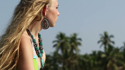 closeup blonde girl in swimsuit necklace and earrings look