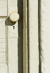 Yellow cracked paint on a door