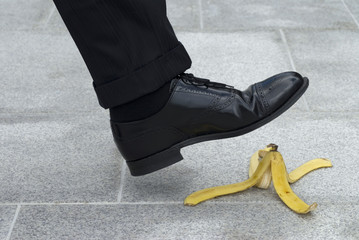 Businessman about to step on a banana skin © david_franklin