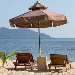 Beach chair and umbrella on the beach in sunny day , Thailand