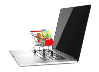 Laptop with small shopping cart full of gifts isolated