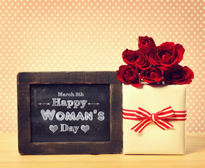 Happy Womans Day message with roses and present box