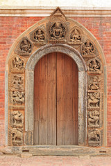 Stone door frame showing mythical creatures in Patan