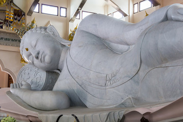 Marble of Reclining Buddha statue in Temple of watpaphukon.