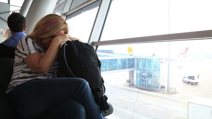 Tired woman waiting at the airport