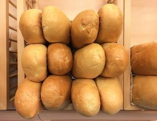 Pile of white bread loaf in bakery shelf