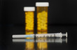 Vaccination syringe with medical vials in background - 77726438