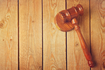 Judge gavel on wooden vintage background