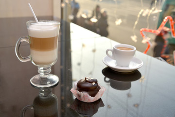 Latte coffee in a glass glass, a cup with coffee of espresso and