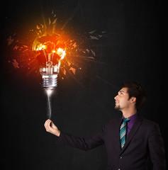 Businessman with an explosion bulb