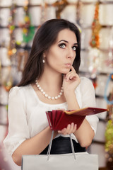 Cute Broke Woman at  Shopping Checking Wallet