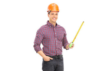 An architect holding a tape measure