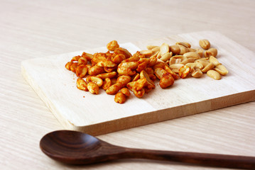 Thai Spicy flavour nuts with wooden spoon