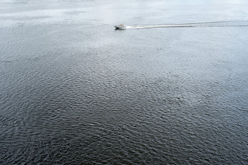 The motor boat floating in the Dnieper waters