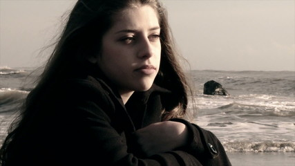 sad girl on the beach in winter