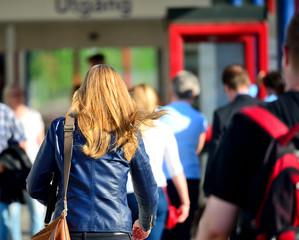 Woman walking in crowd