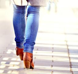 Woman walking into bright light (future?)