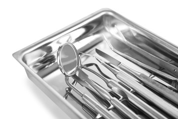 Set dentist tools on tray isolated on white