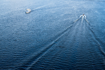 The boats floating in the blue Dnieper waters