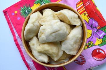 Вареники с картошкой  в сметане с луком