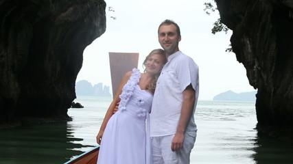 bride put her head on husband's shoulder