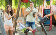 Daughters on swings with parents