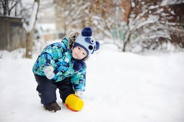 baby boy on snow background
