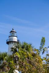 White Lighthouse on Blue Beyond Green