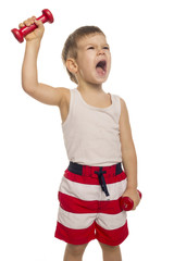 little boy picks up a dumbbell