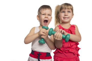 little boy and girl lift dumbbells