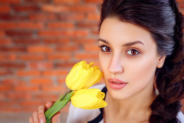 Beautiful brunette woman with tulips