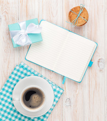 Cup of coffee, gingerbread cookies gift box and notepad