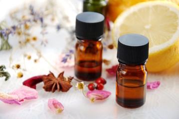 essential oils with herbs and lemon