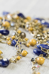 Gold Jewelry with Yellow and Blue Stone Accents