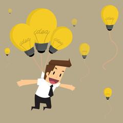 businessman fly with idea bulb balloon