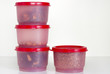 Filled plastic containers
