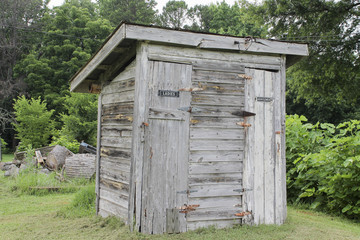 old wooden bathroom in the field