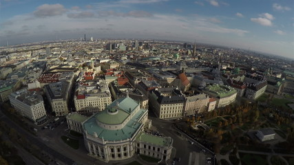 Camera flying above Austrian National Theater in Vienna (Burgthe