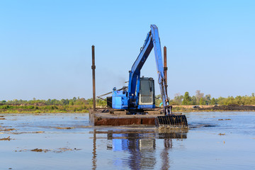 excavator working in the river