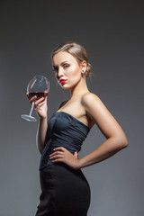 Woman in black dress with wine glass