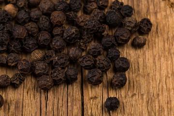 black pepper on wooden table
