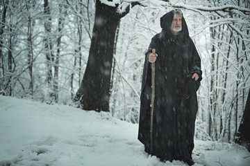 Old pilgrim in iced forest