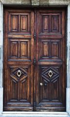 Old wooden door with metal knocker