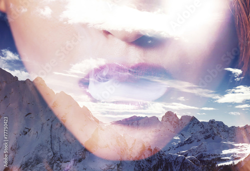 Double exposure of woman mouth smoking and mountainscape - 77750423