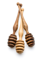 Carving wooden honey dipper spoon isolated on white background c