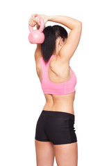 Woman in sportswear doing exercises with kettlebell