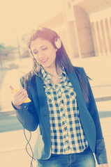 girl listening music from his smart phone applied filter instagr