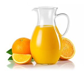 Jug with orange juice and fruits with green leaves isolated