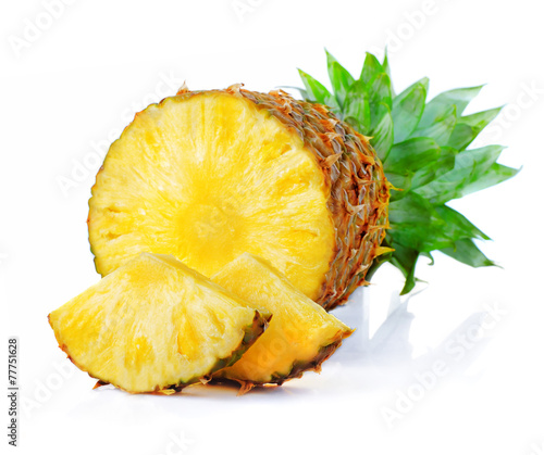 Fresh pineapple fruits with cut and green leaves isolated on whi - 77751628